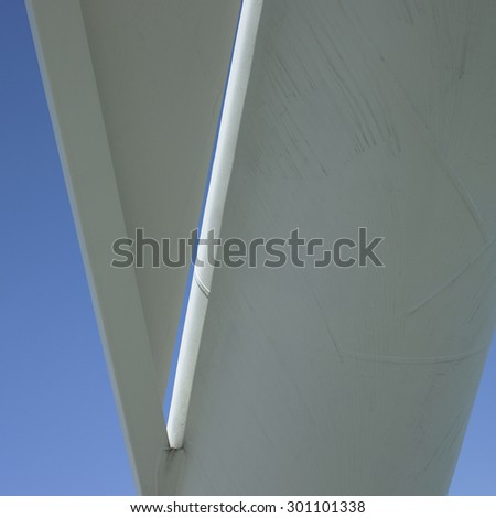 White urban abstract architecture feature against blue sky - stock photo