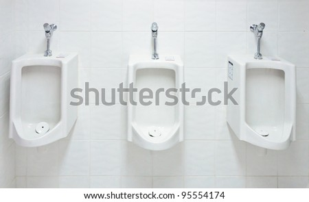 White urinal in the restroom of hotel. - stock photo