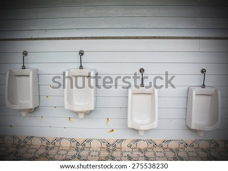 White urinals for men and boys - stock photo