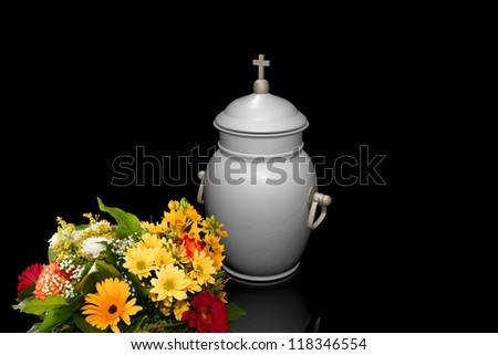 White urn with a bouquet of flowers - stock photo