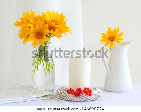 White vase,white candle and red currant with yellow flower,still life - stock photo