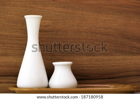 White vases in a wooden tray - stock photo