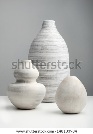 White Vases on a white surface - stock photo