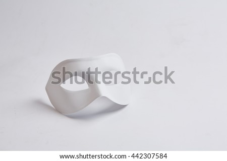 white venetian mask on a white background