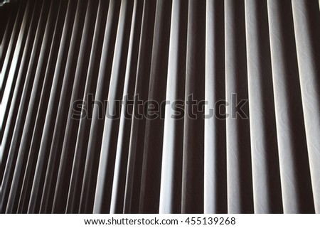 White vertical blinds with a chain in the office - stock photo