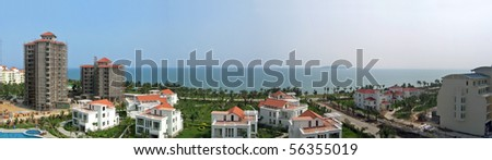 white villas and new construction on the sanya seafront - stock photo
