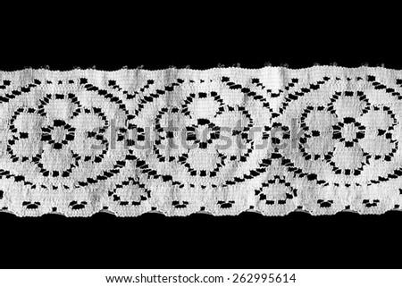 White vintage border lace isolated over black - stock photo