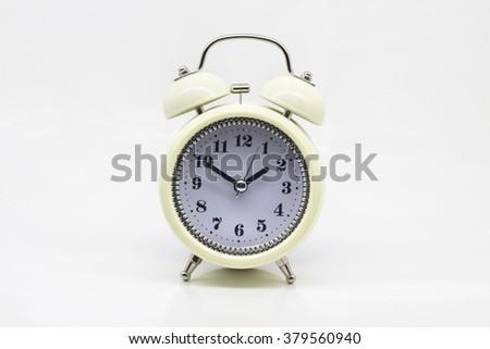 White vintage clock on isolated white background - stock photo