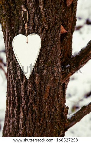 white vintage heart hanging on the tree. Valentine's day  or Christmas decoration. - stock photo