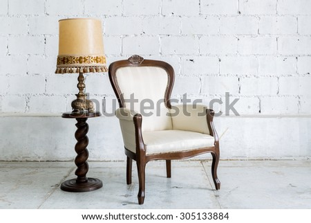 White Vintage retro style Chair with lamp - stock photo
