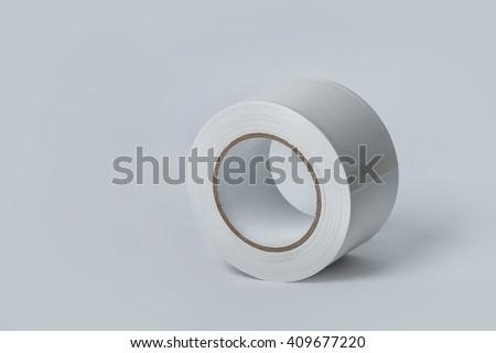 White vinyl electrical tape on white background - stock photo