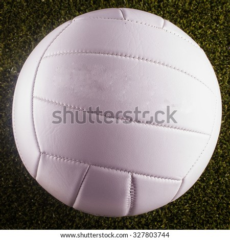 White Volley ball over grass, square image - stock photo