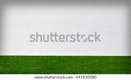 white wall and green grass texture background  - stock photo