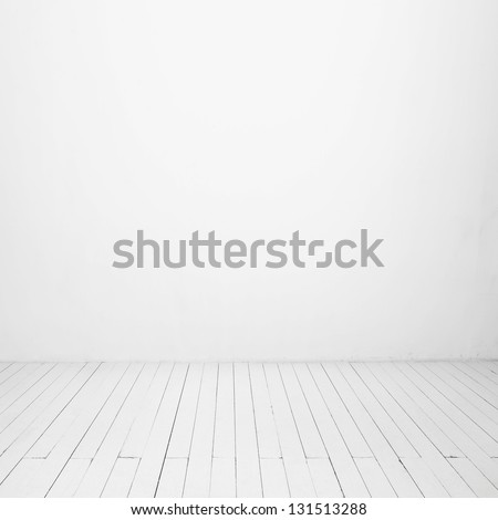 white wall and wood floor