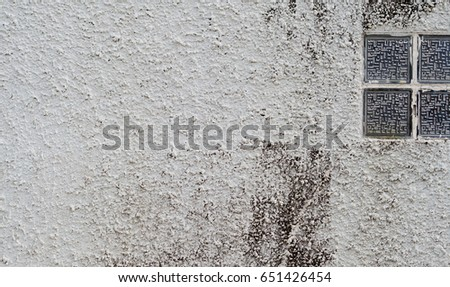 white wall background with glass window
