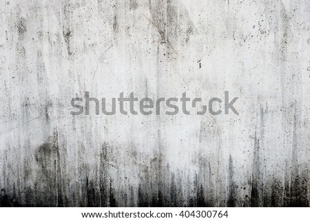 White wall of stained concrete - stock photo