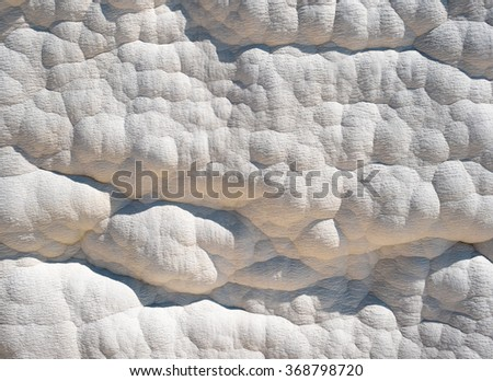 """White wall on travertines, textured background at Pamukkale reserve. Natural travertine pools and terraces in Pamukkale resort. Pamukkale or """"cotton castle"""", Turkey. - stock photo"""