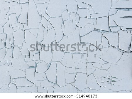 White wall with cracking paint texture