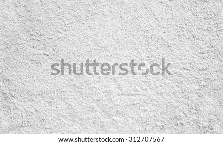 White wall with relief plaster pattern. Seamless background photo texture