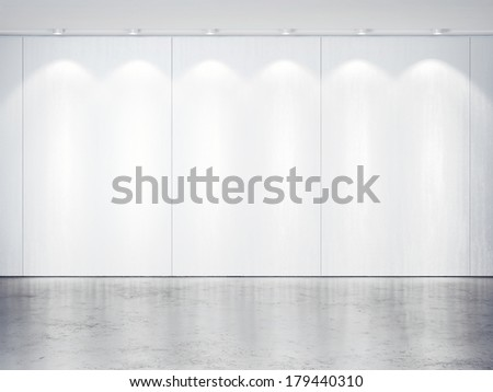 White wall with spotlights. Concrete floor. - stock photo