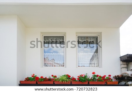 White wall with two windows