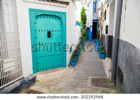 White walls and green door. Medina, old part of Tangier, Morocco - stock photo
