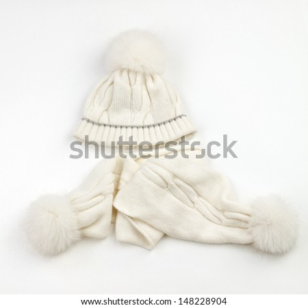 White warm woolen knitted winter hat and scarf  - stock photo