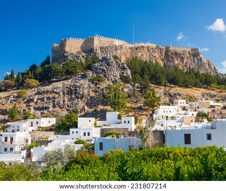 White washed houses with the castle above at Lindos on the Greek Island of Rhodes Greece Europe