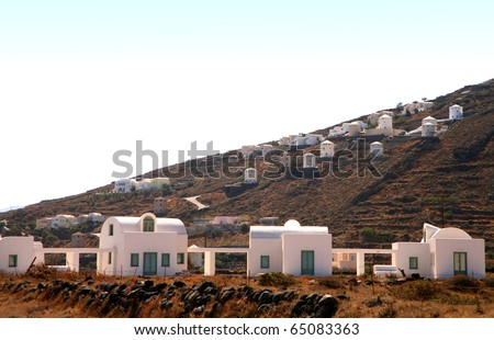 white washed modern houses on island of santorini, greece