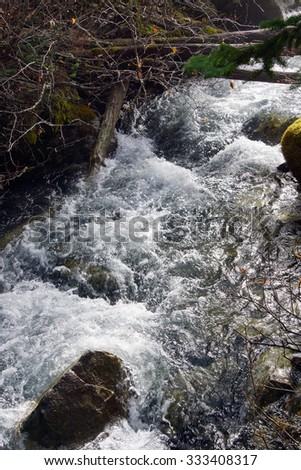 White water crashes down the valley between Joffre Lakes, British Columbia, Canada