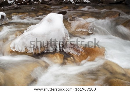White water moves over large rocks in an Idaho wilderness stream liquid flowing - stock photo