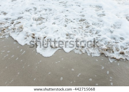 White water on a beach. Sandy beach.
