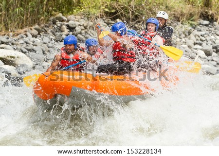 White water rafting team in bright sunlight, Pastaza river, Ecuador, Sangay National Park.