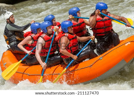 White water rafting team in bright sunlight, Pastaza river, Ecuador, Sangay National Park. - stock photo
