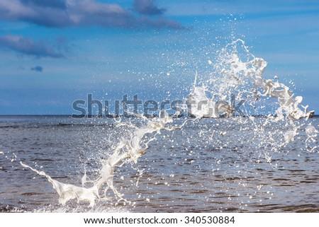 White watercolour splash on sea background - stock photo
