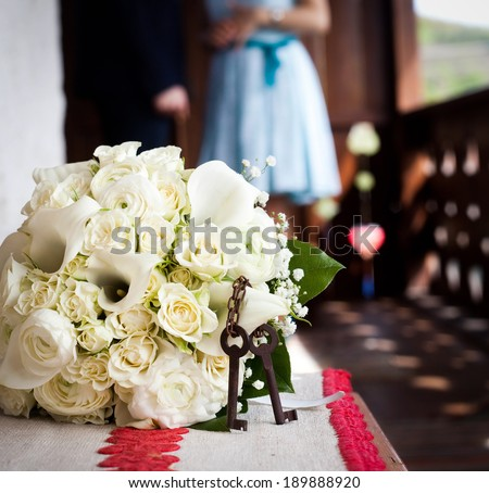 White wedding bouquet and old rusty keys