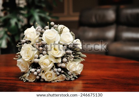 white wedding bouquet of roses. - stock photo