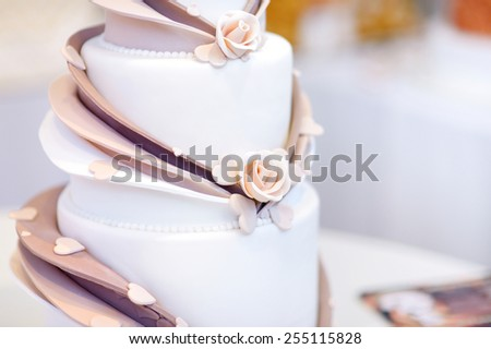White wedding cake decorated with beige sugar flowers - stock photo