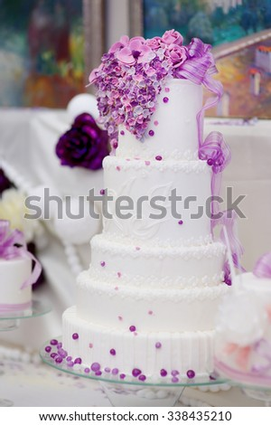 White wedding cake decorated with sugar purple bubbles - stock photo