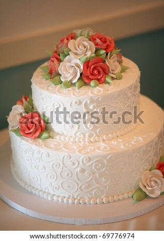 White wedding cake with orange and green flowers - stock photo