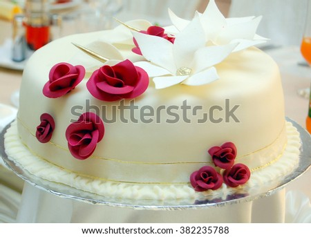 white wedding cake with red roses - stock photo