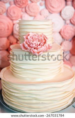 white wedding cake with signle eatable pink rose - stock photo