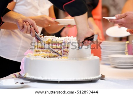 White wedding cake with strawberry on wedding party