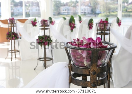 White wedding chapel decorated with beautiful flowers. - stock photo