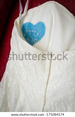 White wedding dress up close detail - stock photo