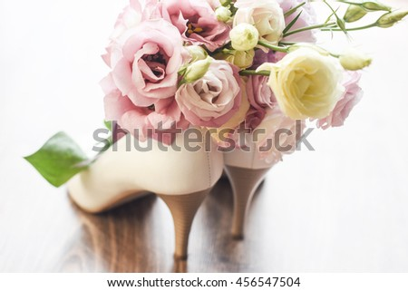 White wedding shoes and wedding bouquet.