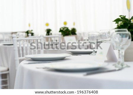 White wedding table in sunlight - stock photo