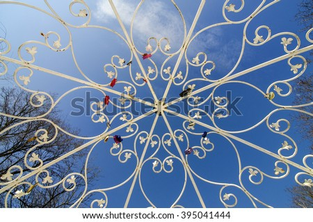 White wedding tracery openwork lattice against the blue sky. - stock photo