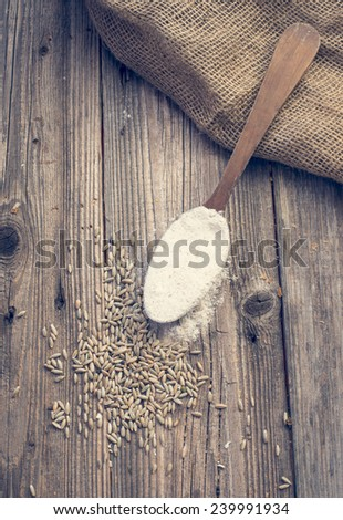 White wheat in a spoon and rye - stock photo
