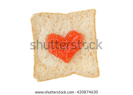 White whole wheat bread slice with heart shape jam isolated on white background with clipping path - stock photo